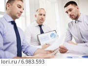 Купить «serious businessmen with papers in office», фото № 6983593, снято 10 мая 2014 г. (c) Syda Productions / Фотобанк Лори