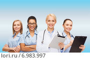 Купить «smiling female doctor and nurses with tablet pc», фото № 6983997, снято 1 декабря 2013 г. (c) Syda Productions / Фотобанк Лори