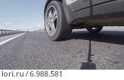Купить «Вращающийся стальной диск колеса автомобиля едущего по скоростной автотрассе, вид снизу», видеоролик № 6988581, снято 23 января 2015 г. (c) Кекяляйнен Андрей / Фотобанк Лори