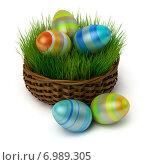 Купить «Пасхальные яйца в корзине с травой», иллюстрация № 6989305 (c) Anatoly Maslennikov / Фотобанк Лори