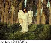 Купить «Wonderful female angel walking across the forest», фото № 6997945, снято 29 апреля 2014 г. (c) Ingram Publishing / Фотобанк Лори