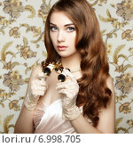 Купить «Portrait of young woman with binoculars. Fashion portrait», фото № 6998705, снято 20 июля 2014 г. (c) Ingram Publishing / Фотобанк Лори