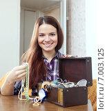 Купить «woman chooses jewelry in treasure chest», фото № 7003125, снято 13 января 2013 г. (c) Яков Филимонов / Фотобанк Лори