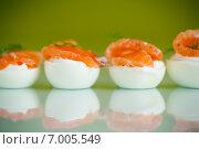 Купить «Яйца фаршированные соленой красной рыбой», фото № 7005549, снято 12 февраля 2015 г. (c) Peredniankina / Фотобанк Лори