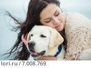 Купить «The young woman on an autumn beach with a dog.», фото № 7008769, снято 23 мая 2018 г. (c) Александр Савченко / Фотобанк Лори