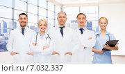 Купить «group of smiling doctors with clipboard», фото № 7032337, снято 15 апреля 2014 г. (c) Syda Productions / Фотобанк Лори