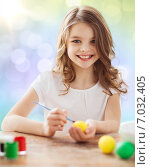 Купить «happy girl with brush coloring easter eggs», фото № 7032405, снято 1 марта 2014 г. (c) Syda Productions / Фотобанк Лори