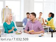 Купить «smiling fashion designers having lunch at office», фото № 7032509, снято 17 мая 2014 г. (c) Syda Productions / Фотобанк Лори