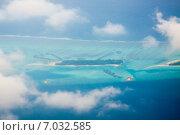 Купить «Мальдивские острова, вид с высоты птичьего полета», фото № 7032585, снято 12 февраля 2013 г. (c) Сергей Дубров / Фотобанк Лори