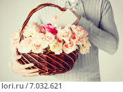 Купить «man holding basket full of flowers and postcard», фото № 7032621, снято 6 марта 2013 г. (c) Syda Productions / Фотобанк Лори