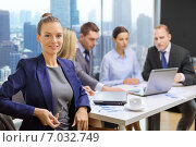 businesswoman over business team in office. Стоковое фото, фотограф Syda Productions / Фотобанк Лори