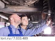 Купить «Two man fixing car», фото № 7033489, снято 19 августа 2018 г. (c) Яков Филимонов / Фотобанк Лори
