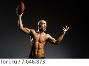 Купить «Muscular football player with ball», фото № 7046873, снято 30 ноября 2012 г. (c) Elnur / Фотобанк Лори