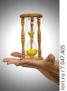 Купить «Hand holding hourglass on white», фото № 7047405, снято 3 мая 2012 г. (c) Elnur / Фотобанк Лори