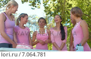 Купить «In high quality format smiling women in pink for breast cancer awareness», видеоролик № 7064781, снято 17 февраля 2019 г. (c) Wavebreak Media / Фотобанк Лори