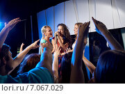Купить «happy young women singing karaoke in night club», фото № 7067029, снято 20 октября 2014 г. (c) Syda Productions / Фотобанк Лори