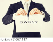 man hands tearing contract paper. Стоковое фото, фотограф Syda Productions / Фотобанк Лори