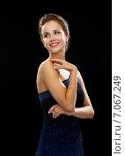 Купить «smiling woman in evening dress touching shoulder», фото № 7067249, снято 1 июня 2014 г. (c) Syda Productions / Фотобанк Лори