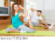 Couple practicing yoga at home. Стоковое фото, фотограф Яков Филимонов / Фотобанк Лори
