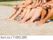 Купить «close up of friends sitting on summer beach», фото № 7093285, снято 3 августа 2014 г. (c) Syda Productions / Фотобанк Лори