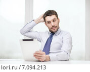 Купить «stressed businessman with tablet pc and documents», фото № 7094213, снято 15 марта 2014 г. (c) Syda Productions / Фотобанк Лори