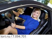 Купить «happy woman inside car in auto show or salon», фото № 7094701, снято 22 января 2015 г. (c) Syda Productions / Фотобанк Лори