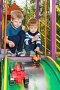 Дети играют в машинки на детской площадке, эксклюзивное фото № 7095541, снято 13 сентября 2014 г. (c) Алексей Бок / Фотобанк Лори
