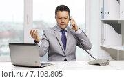 Купить «businessman with laptop calling on phone», видеоролик № 7108805, снято 6 февраля 2015 г. (c) Syda Productions / Фотобанк Лори