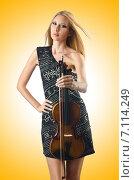 Купить «Woman playing violin on white», фото № 7114249, снято 30 июля 2012 г. (c) Elnur / Фотобанк Лори