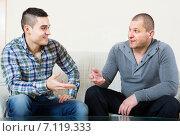 Купить «Buddies chatting in home interior», фото № 7119333, снято 22 сентября 2018 г. (c) Яков Филимонов / Фотобанк Лори