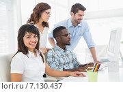Купить «Teamwork using computer monitor together», фото № 7130437, снято 27 мая 2014 г. (c) Wavebreak Media / Фотобанк Лори