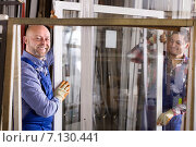 Купить «Two workers inspecting windows», фото № 7130441, снято 17 августа 2018 г. (c) Яков Филимонов / Фотобанк Лори