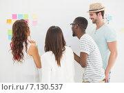 Купить «Rear view of coworkers interacting together», фото № 7130537, снято 27 мая 2014 г. (c) Wavebreak Media / Фотобанк Лори