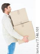 Купить «Delivery man carrying cardboard boxes», фото № 7146101, снято 20 июня 2019 г. (c) Wavebreak Media / Фотобанк Лори