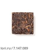 Купить «Брикет прессованного китайского чая Pu-erh на белом фоне», фото № 7147089, снято 17 марта 2015 г. (c) EugeneSergeev / Фотобанк Лори