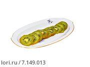 Купить «Киви нарезанное кольцами на блюдце», фото № 7149013, снято 31 декабря 2014 г. (c) Рамиль Усманов / Фотобанк Лори