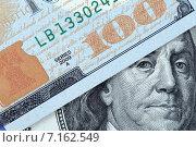 Купить «Бенджамин Франклин выглядывает из-за стодолларовой купюры», фото № 7162549, снято 22 марта 2015 г. (c) Игорь Долгов / Фотобанк Лори