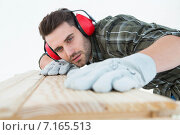 Купить «Carpenter measuring wooden plank», фото № 7165513, снято 19 августа 2019 г. (c) Wavebreak Media / Фотобанк Лори