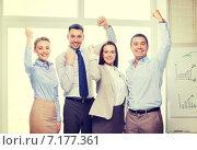 Купить «business team celebrating victory in office», фото № 7177361, снято 5 апреля 2014 г. (c) Syda Productions / Фотобанк Лори