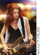 Купить «red haired woman playing guitar on stage», фото № 7178293, снято 11 декабря 2014 г. (c) Syda Productions / Фотобанк Лори