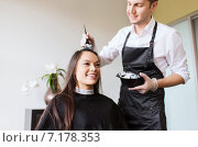 Купить «happy young woman coloring hair at salon», фото № 7178353, снято 15 февраля 2015 г. (c) Syda Productions / Фотобанк Лори