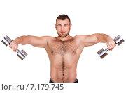 Купить «Muscular bodybuilder guy doing exercises with dumbbells isolated over white background», фото № 7179745, снято 22 марта 2019 г. (c) Александр Савченко / Фотобанк Лори