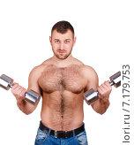 Купить «Muscular bodybuilder guy doing exercises with dumbbells isolated over white background», фото № 7179753, снято 22 марта 2019 г. (c) Александр Савченко / Фотобанк Лори
