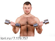 Купить «Muscular bodybuilder guy doing exercises with dumbbells isolated over white background», фото № 7179757, снято 22 марта 2019 г. (c) Александр Савченко / Фотобанк Лори