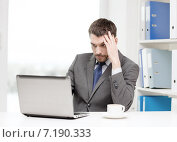 busy businessman with laptop and coffee, фото № 7190333, снято 15 марта 2014 г. (c) Syda Productions / Фотобанк Лори