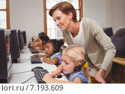 Купить «Cute pupils in computer class with teacher», фото № 7193609, снято 8 ноября 2014 г. (c) Wavebreak Media / Фотобанк Лори