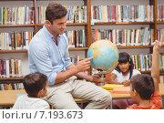 Купить «Cute pupils and teacher looking at globe in library», фото № 7193673, снято 8 ноября 2014 г. (c) Wavebreak Media / Фотобанк Лори
