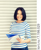 Купить «happy and smiling teenage girl with big notepad», фото № 7198029, снято 7 апреля 2012 г. (c) Syda Productions / Фотобанк Лори