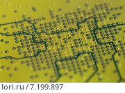Купить «Фрагмент печатной платы компьютера в месте установки чипа», фото № 7199897, снято 28 марта 2015 г. (c) Игорь Долгов / Фотобанк Лори