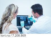 Купить «Dentist showing woman prosthesis teeth», фото № 7208869, снято 16 апреля 2014 г. (c) Wavebreak Media / Фотобанк Лори